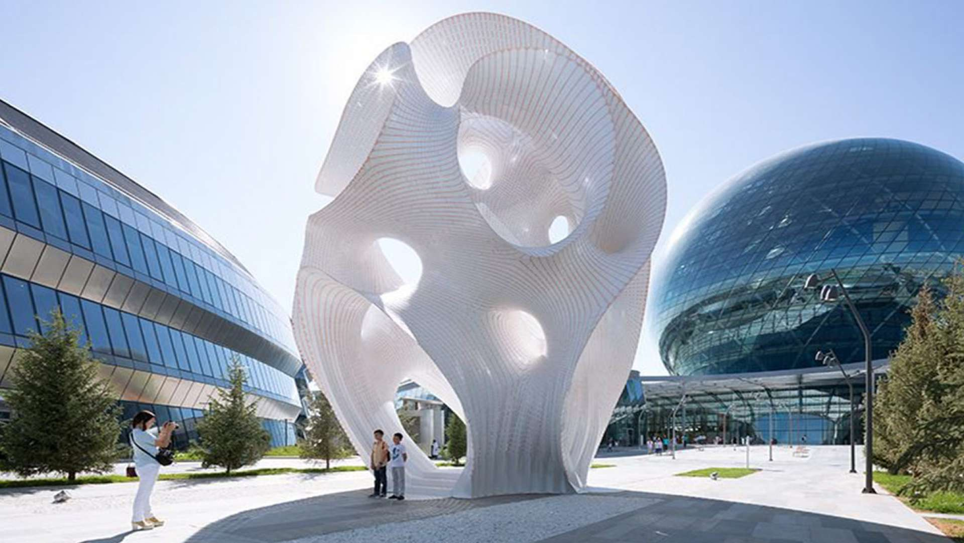 A Towering 4-Story Organic Structure Built From Material as Thin as a Coin by Christopher Jobson